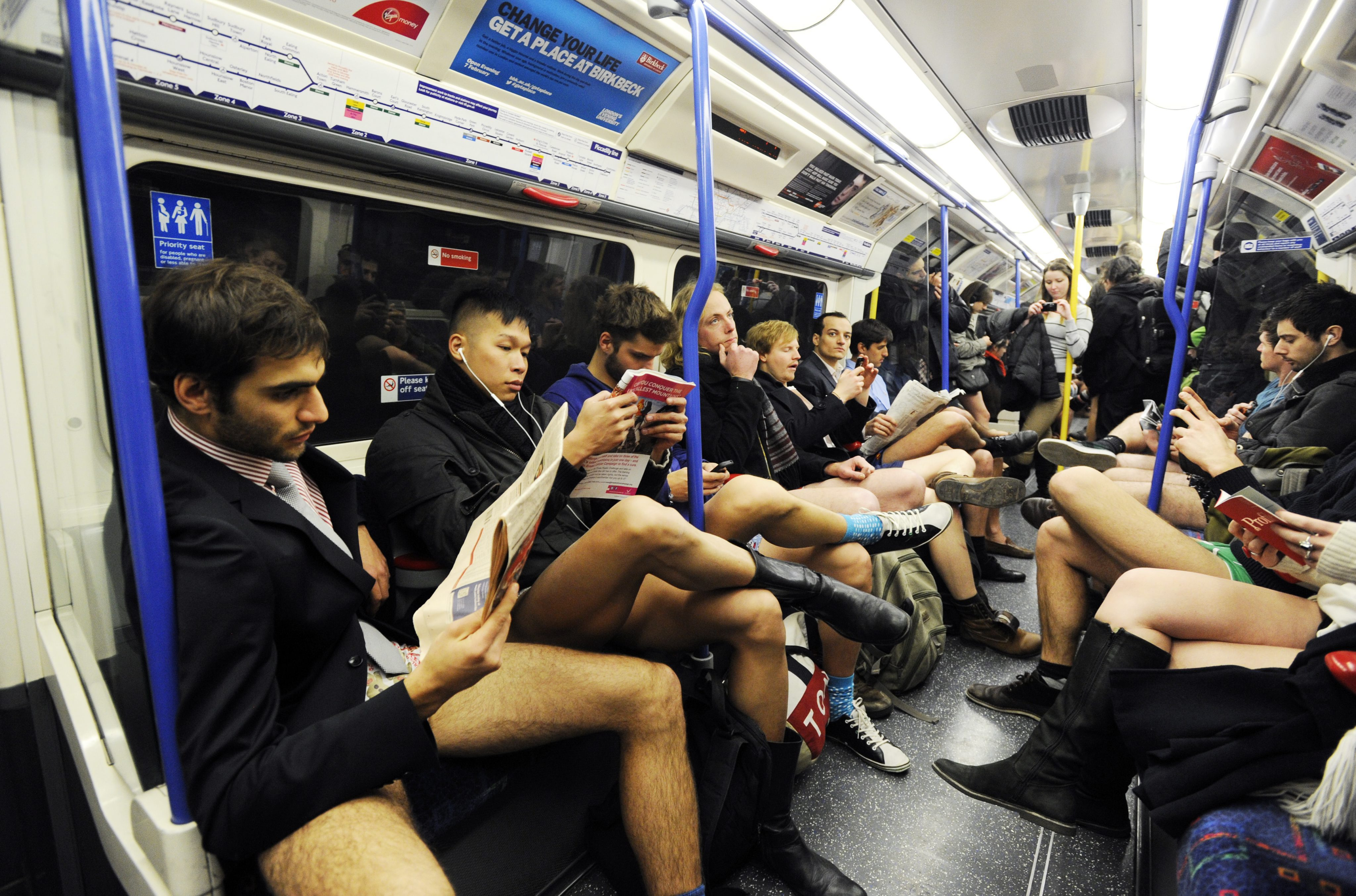 epa03533904 People take part in a No Trousers Day 2013 flash mob on the London Underground, in London, Britain, 13 January 2013. The event is organized by Improv Everywhere and takes place in many cities across the world. The goal for the participants is to get on public transport dressed in normal winter clothes, but without pants while keeping a straight face.  EPA/FACUNDO ARRIZABALAGA