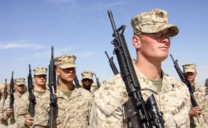 U.S. Marines march during a ceremony where the authorities handed over the town of Heet to Iraqi forces in Anbar province February 14, 2008. REUTERS/Ammar Dulaimi     (IRAQ) - RTR1X3IO