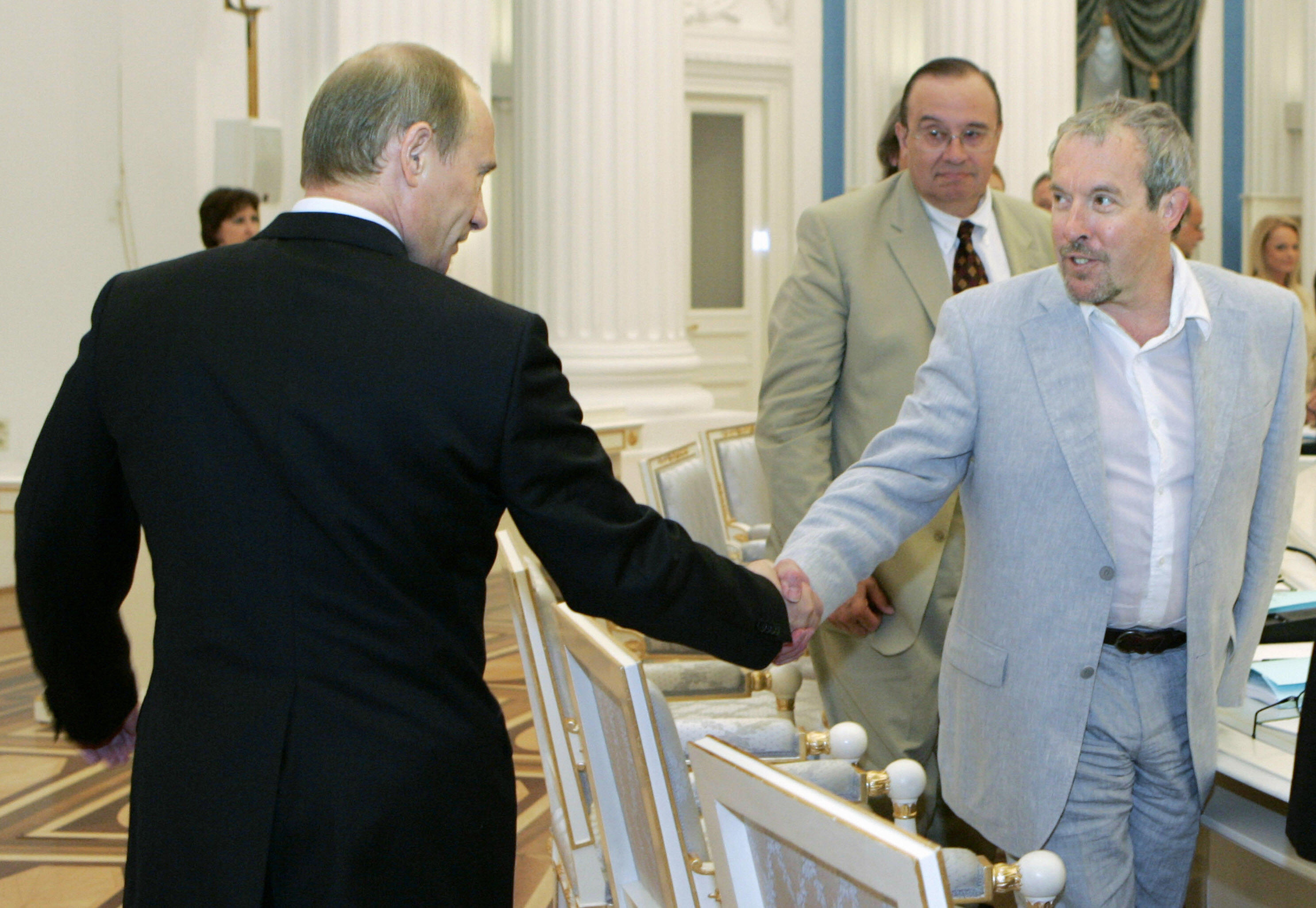 Moscow, RUSSIAN FEDERATION: Russian President Vladimir Putin (L) shakes hands with musician Andrey Makarevich during a meeting of the Culture and Art Council in the Kremlin in Moscow, 30 May 2007. AFP PHOTO / ITAR-TASS / PRESIDENTIAL PRESS SERVICE (Photo credit should read DMITRY ASTAKHOV/AFP/Getty Images)