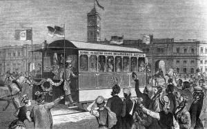 Их королевские Высочества принц и принцесса Пьемонтские в экипаже конно-железной дороги перед Николаевским вокзалом. Гравюра Э. Дамюллера с рисунка А. Бальдингера